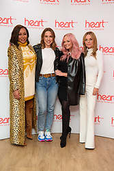 Spice Girls (left to right) Melanie Brown, Melanie Chisholm, Geri Horner and Emma Bunton at a live appearance this morning on the Heart Breakfast show with host Jamie Theakston at Global Radio in Leicester Square, London.