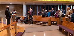 "Bishop Ernst Gamxaub of Namibia leads a round of ""A Mighty Fortress Is Our God"" before speaking at Trinity Lutheran on Monday, April 25, 2016. (Photo: John Froschauer/PLU)"