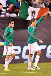 February 24, 2010; San Francisco, CA, USA;  Mexico forward Javier Hernandez (11) and forward Pablo Berrera (15) celebrate after a goal against Bolivia during the first half at Candlestick Park. Mexico defeated Bolivia 5-0.