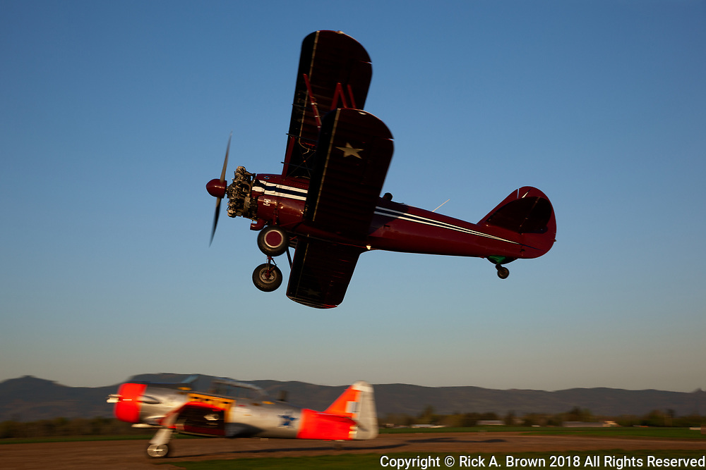 """N3N-3 """"Old Glory"""" in flight with a team from the Vintage Air Rally."""