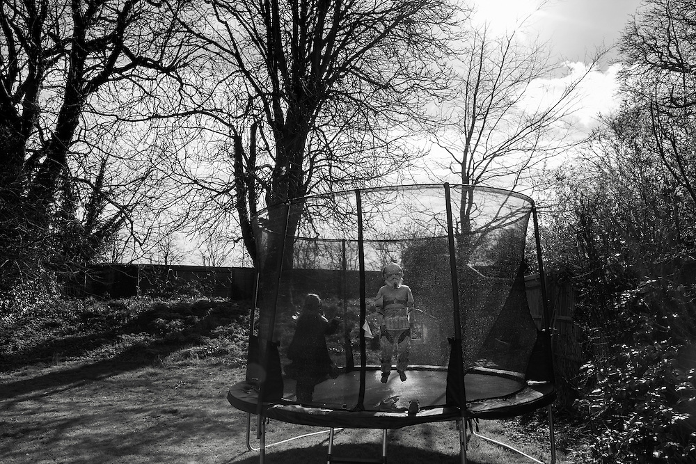 Ben dressed as a storm trooper jumps on a trampoline with his friend Izzy at her house in England Thursday, April 2, 2015 (Elizabeth Dalziel) #thesecretlifeofmothers #bringinguptheboys #dailylife