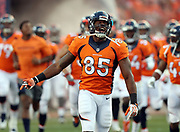 Denver Broncos tight end Virgil Green (85) yells out with emotion as he runs onto the field with teammates before 2016 NFL week 1 regular season football game against the Carolina Panthers on Thursday, Sept. 8, 2016 in Denver. The Broncos won the game 21-20. (©Paul Anthony Spinelli)