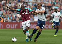 Football - 2017 / 2018 Premier League - West Ham United vs Tottenham Hotspur<br /> <br /> Harry Kane (Tottenham FC) and Angelo Ogbonna (West Ham United)  compete for the ball at the London Stadium<br /> <br /> COLORSPORT/DANIEL BEARHAM