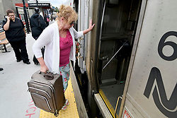 Betsy Simon, of Straford, NJ, boards the train to Atlantic City on the Atlantic City Rail Line platform, in Lindenwold, NJ, on August 20, 2018. The scheduled installation of PCT will temporary interrupt ACRL service till the end of December. (Bastiaan Slabbers for WHYY)