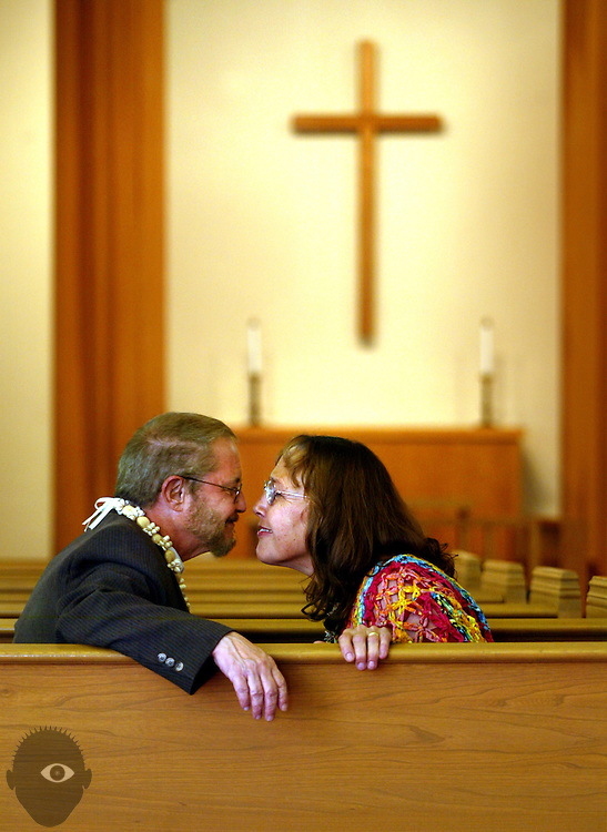 Reverend David Weekley and his wife Deborah share a quiet moment in the chapel at Epworth United Methodist Church after coming out to his congregation at Sunday's worship as the second transgender Methodist clergy in the nation. They were happily embraced and supported by them.  His church is 95% Japanese-American (Epworth United Methodist Church is historically Japanese-American) and none of them know that he was born a she and had transitioning surgery 34 years ago.  This is going to be a big shock to the community and potentially hazardous to Weekley, as the Methodist church does not support LGBTQ rights.