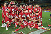 The Reds celebrate with the Templeton Cup. Queensland Reds v NSW Waratahs. Investec Super Rugby Round 10 Match, 24 April 2011. Suncorp Stadium, Brisbane, Australia. Reds won 19-15. Photo: Clay Cross / photosport.co.nz