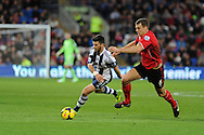 WBA's Shane Long (l) breaks away from Cardiff city's Ben Turner. Barclays Premier league, Cardiff city v West Bromwich Albion at the Cardiff city Stadium in Cardiff, South Wales on Saturday 14th Dec 2013. pic by Andrew Orchard, Andrew Orchard sports photography.
