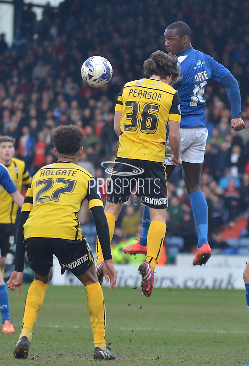Jonathan Forte beats Ben Pearsonto the ball  during the Sky Bet League 1 match between Oldham Athletic and Barnsley at Boundary Park, Oldham, England on 14 March 2015. Photo by Mark Pollitt.