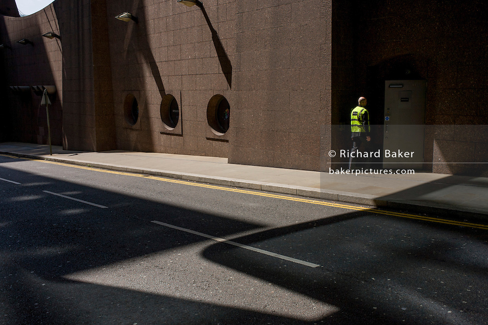 Security patrol in an urban landscape of modern architecture at Broadgate in the City of London.