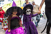 Mexican children parade in costumes celebrating the Day of the Dead festival known in Spanish as Día de Muertos at the town square October 31, 2013 in Oaxaca, Mexico.