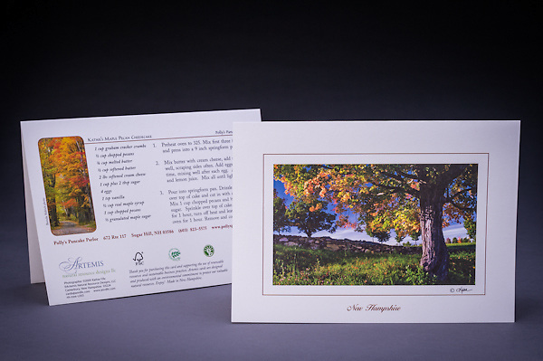 "A scenic fall landscape with a sugar maple in foliage, fields, and a stonewall.  Recipe on the back of the card for ""Kathie's Maple Pecan Cheesecake"".  This card was custom designed for Polly's Pancake Parlor, in Sugar Hill, NH.   <br />