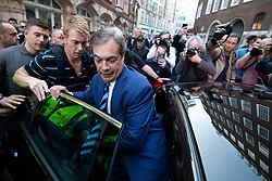 © Licensed to London News Pictures. 29/03/2019. Former Leader of UKIP, Nigel Farage (centre), leaves after speaking on stage at a Leave Means Leave demonstration in Westminster on the day that Britain was originally due to leave the European Union. MPs today rejected Theresa May's withdrawal deal for the third time. Photo credit : Tom Nicholson/LNP