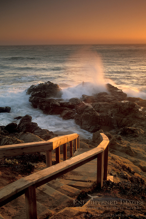 Wooden stairs leading down ocean wave crashing on coastal rocks at sunset, Leffingwell Landing, Cambria, California