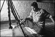 "Sri Lanka.<br /> Craftsman weaving 'Dumbara"" mats at a pit loom.<br /> Copyright: Dominic Sansoni"