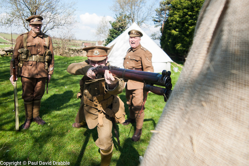 Renactors portraying the Cheshire Regiment during the first world war undertake training behind the Elm Tree Pub before they take part in a reenactment in Elmton in June..Ed Wilson Practicing with fixed Bayonet ..20 April  2013.Image © Paul David Drabble
