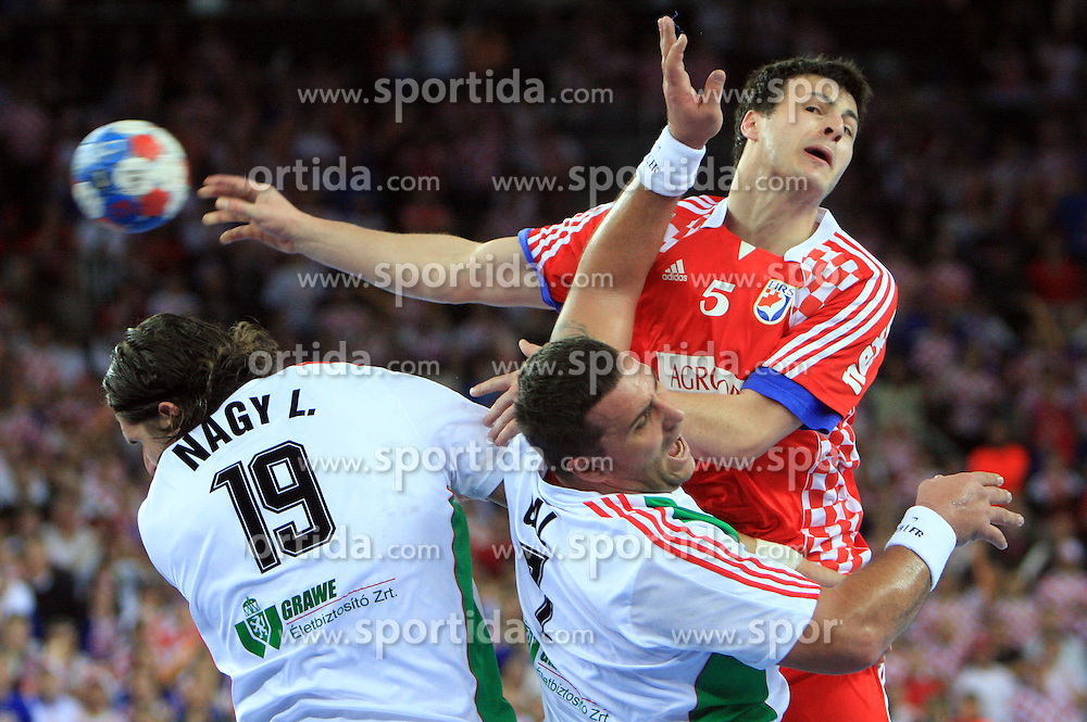Domagoj Duvnjak (5) of Croatia vs Laszlo Nagy (19) and Gyula Gal of Hungary during 21st Men's World Handball Championship 2009 Main round Group I match between National teams of Croatia and Hungary, on January 24, 2009, in Arena Zagreb, Zagreb, Croatia.  (Photo by Vid Ponikvar / Sportida)