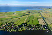 Nederland, Noord-Holland, Gemeente Amsterdam, 13-06-2017; dorpje Holysloot, gelegen in Landelijk Noord. Dorpsstraat en Holysloter Die. Kinselmeer in de achtergrond, Amsterdam aan de horizon.<br /> The small village Holysloot, north of Amsterdam in rural area.<br /> luchtfoto (toeslag op standaard tarieven);<br /> aerial photo (additional fee required);<br /> copyright foto/photo Siebe Swart