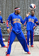 "The Harlem Globetrotters' Brawley ""Cheese"" Chisholm, center, and Deandre ""Dragon"" Taylor, right, show off some basketball handling skills in advance of a pair of upcoming dates for shows at the Arena at Gwinnett during a rare day off, Monday, March 9, 2015, in Atlanta. David Tulis / AJC Special"