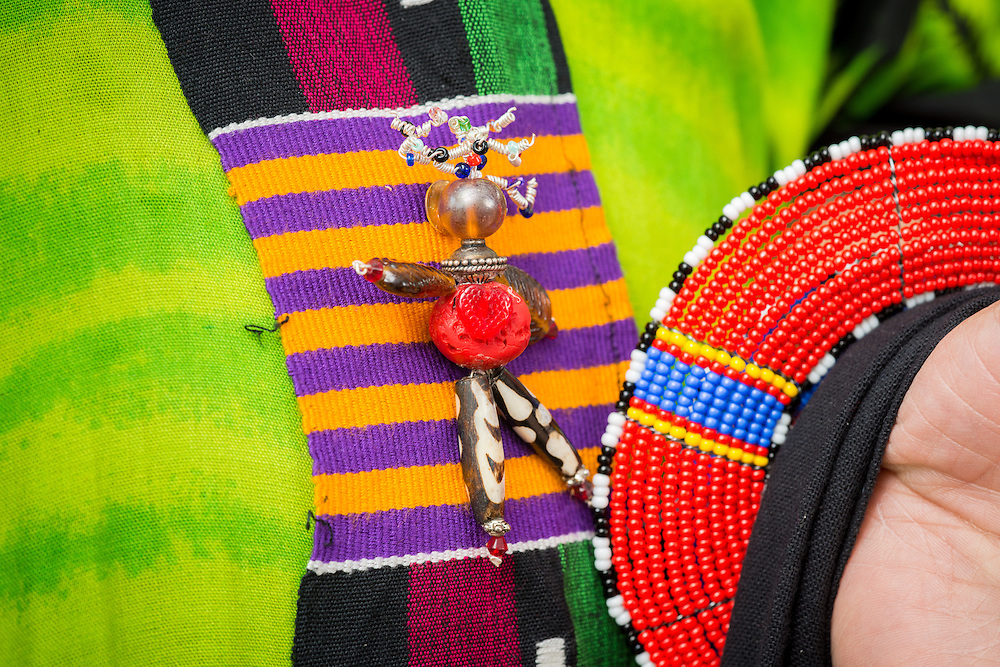 close-up of colorful pin made from large beads on African garment in Baltimore, Maryland