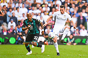 Leeds United midfielder Jack Harrison (22) and Swansea City forward Andre Ayew (22) during the EFL Sky Bet Championship match between Leeds United and Swansea City at Elland Road, Leeds, England on 31 August 2019.