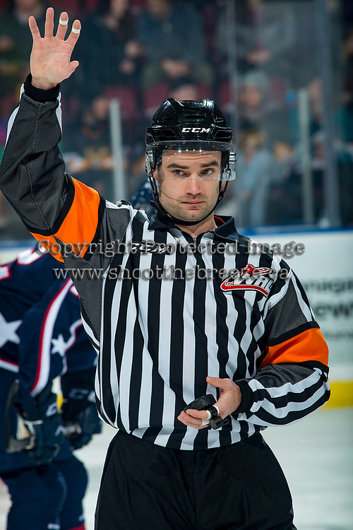 KELOWNA, BC - FEBRUARY 12: Referee Ryan Benbow stands at centre ice for the face-off between the Kelowna Rockets and the Tri-City Americans at Prospera Place on February 8, 2020 in Kelowna, Canada. (Photo by Marissa Baecker/Shoot the Breeze)