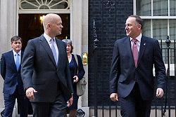 © Licensed to London News Pictures. 18/09/2013. London, UK. Accompanied by the British Foreign Secretary William Hague, the New Zealand Prime Minister John Key (R) is seen leaving Number 10 Downing Street in London today (18/09/2013) after talks on with the British Prime Minister David Cameron in London today (18/09/2013). Photo credit: Matt Cetti-Roberts/LNP
