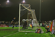 Repairs to the net before the The FA Cup 2nd round replay match between Whitehawk FC and Dagenham and Redbridge at The Enclosed Ground, Whitehawk, Brighton, United Kingdom on 16 December 2015. Photo by Ellie Hoad.,