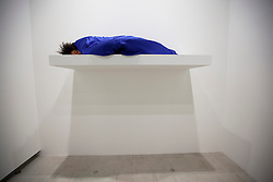 © Licensed to London News Pictures. 05/09/2012. LONDON, UK. A performer lays in a sleeping bag on artist Yingmei Duan's installation piece 'Sleeping' (2004/2012) as part of a new exhibition at the Hayward Gallery in London today. The exhibition, entitled 'Art of Change: New Directions from China' focuses on contemporary installation and performance art by some of China's most innovative artists and artist groups from the 1990s to the present day and runs from 7 September 2012 to 9 December 2012. Photo credit: Matt Cetti-Roberts/LNP