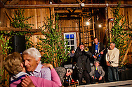 Birgitta Erson and Helge Brøms dancing in the old fire station  during the village party in Västanvik, Sweden