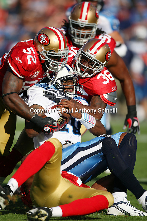 Tennessee Titans quarterback Vince Young (10) gets sacked for a nine yard loss in the second quarter by San Francisco 49ers linebacker Patrick Willis (52), cornerback Shawntae Spencer (36), and linebacker Manny Lawson (99) during the NFL football game against the San Francisco 49ers, November 8, 2009 in San Francisco, California. The Titans won the game 34-27. (©Paul Anthony Spinelli)