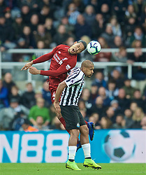 NEWCASTLE-UPON-TYNE, ENGLAND - Saturday, May 4, 2019: Liverpool's Virgil van Dijk (L) and Newcastle United's Salomón Rondón during the FA Premier League match between Newcastle United FC and Liverpool FC at St. James' Park. (Pic by David Rawcliffe/Propaganda)