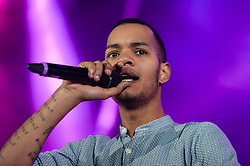 """© Licensed to London News Pictures. 01/03/2014. London, UK.   Rizzle Kicks performing live at Hammersmith Apollo. In this picture - Harley Alexander-Sule.  Rizzle Kicks are an English hip hop duo from Brighton, consisting of Jordan """"Rizzle"""" Stephens and Harley """"Sylvester"""" Alexander-Sule.   Photo credit : Richard Isaac/LNP"""