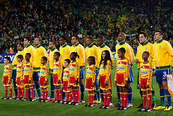 Players of Brazil listening to the national anthem of Chile during the 2010 FIFA World Cup South Africa Round of Sixteen match between Brazil and Chile at Ellis Park Stadium on June 28, 2010 in Johannesburg, South Africa.  (Photo by Vid Ponikvar / Sportida)