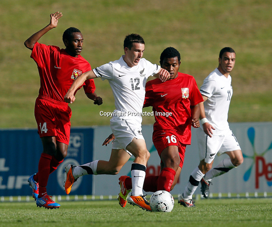 NZ's Louis Fenton mixes it up with PNG's Emmanuel Simon (left) and Kila Polena. OFC Men's Olympic Qualifier New Zealand 2012, New Zealand v Papua New Guinea, Owen Delany Park Taupo, Friday 16th March 2012. Photo: Shane Wenzlick