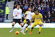 Derby County midfielder George Thorne (34) and Sheffield Wednesday midfielder Lewis McGugan (37) during the Sky Bet Championship match between Derby County and Sheffield Wednesday at the iPro Stadium, Derby, England on 21 February 2015. Photo by Aaron Lupton.