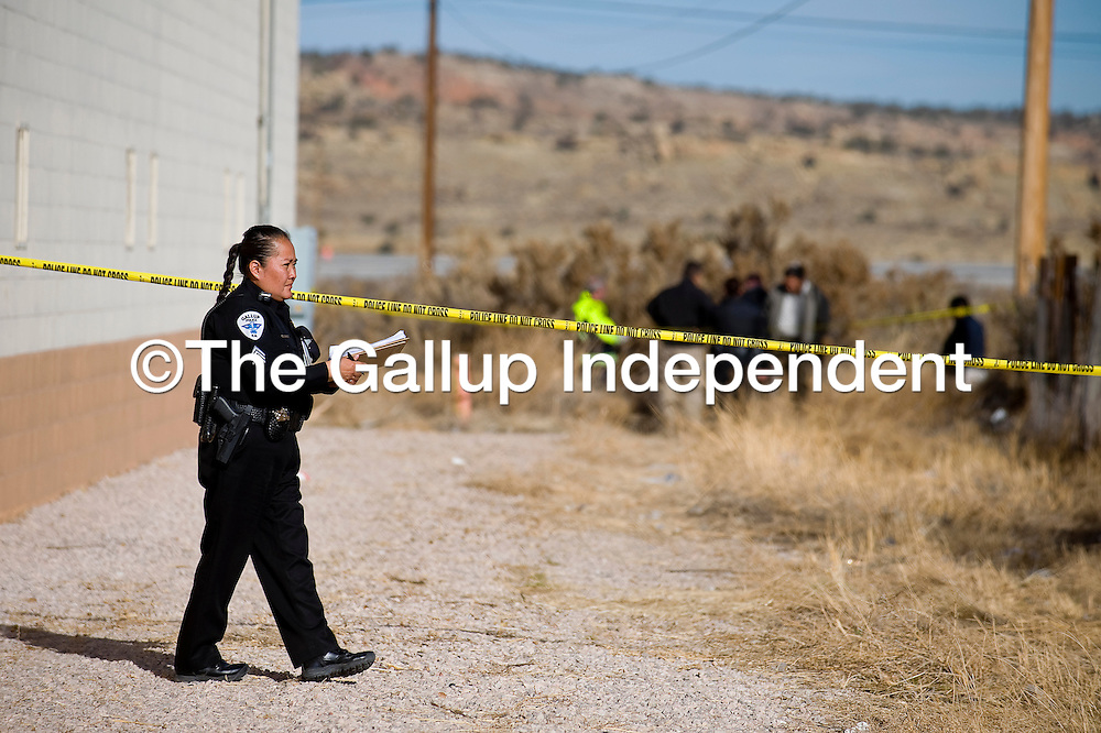 120512     Brian Leddy<br /> A Gallup Police Officer guards the scene where a body was found Wednesday morning. Police were called to the Budget Inn on the west end of Historic Route 66, where the body of a male was found behind the business.