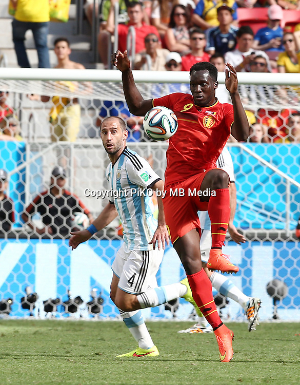 Fifa Soccer World Cup - Brazil 2014 - <br /> ARGENTINA (ARG) Vs. BELGIUM (BEL) - Quarter-finals - Estadio Nacional Brasilia -- Brazil (BRA) - 05 July 2014 <br /> Here Argentine player Pablo Zabaleta () and Belgian player  Romelu LUKAKU ()<br /> &copy; PikoPress