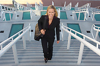 Businesswoman walking up stairs, elevated view