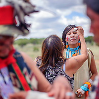 080214       Cable Hoover<br /> <br /> Cheyonne Espinoza has her face powdered with corn meal as she prepares to dance with the Hopi Apache Dancers from Shungopavi, Ariz. during the Ramah Navajo Fair Saturday in Pine Hill.