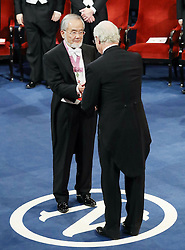 """Nobelpreisverleihung 2016 in der Konzerthalle in Stockholm / 101216 ***Nobel laureate Yoshinori Ohsumi (L) receives a medal and diploma from Swedish King Carl XVI Gustaf at an award ceremony in Stockholm on Dec. 10, 2016. Ohsumi was awarded the Nobel prize in physiology or medicine for elucidating """"autophagy,"""" an intracellular process that degrades and recycles proteins."""