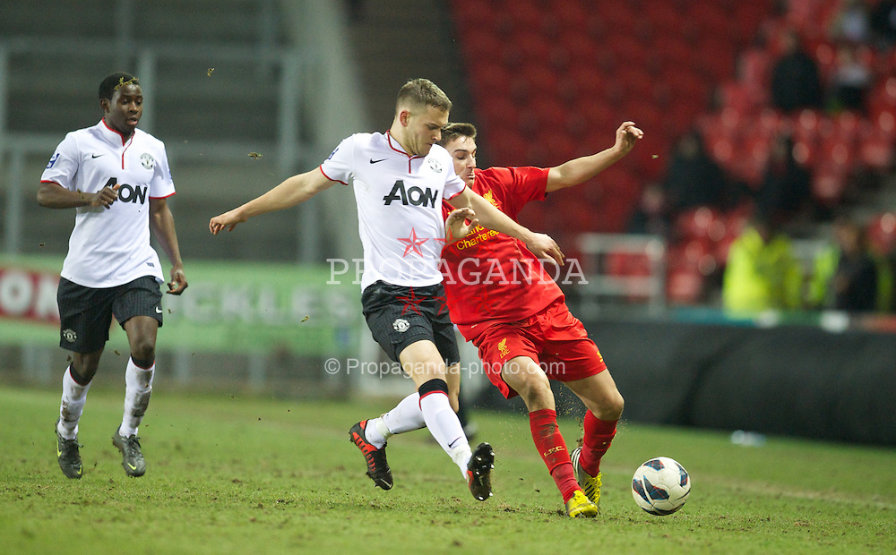 ST HELENS, ENGLAND - Monday, February 25, 2013: Liverpool's Adam Morgan in action against Manchester United's Michele Fornasier during the Premier League Academy match at Langtree Park. (Pic by David Rawcliffe/Propaganda)