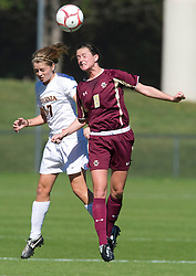 Boston College Eagles midfielder Caitlin Hiler (8) and Virginia Cavaliers midfielder/forward Sinead Farrelly (17) battle for a head ball.  The #9 ranked Virginia Cavaliers defeated the #13 ranked Boston College Eagles 2-1 in NCAA women's soccer at Klockner Stadium on the Grounds of the University of Virginia in Charlottesville, VA on October 19, 2008.