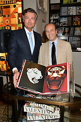 Left to right,  LAURENT FENIOU and PROSPER ASSOULINE at a party to celebrate the publication of Cartier's Panthere book at Maison Assouline, Picadilly, London on 7th September 2015