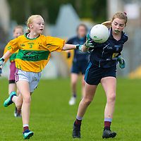 Sophie Leahy tries to win the ball from Amy Lillis.<br /> <br /> Division 1 between Barefield NS and Knockanean NS in the Clare Primary Schools Ladies Football Finals at Cusack Park, Ennis, Co. Clare