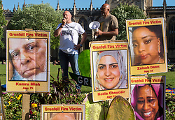 © Licensed to London News Pictures.  14/06/2018; Bristol, UK. TAM MCFARLANE, Fire Brigades Union (FBU) South West Regional Official, speaks at a Vigil on Bristol's College Green for the one year anniversary of the Grenfell Tower fire in London, which caused 72 deaths and many injuries. The vigil was hosted by Avon Fire Brigades Union (FBU) with the FBU's South West Regional Official Tam McFarlane. Photo credit: Simon Chapman/LNP