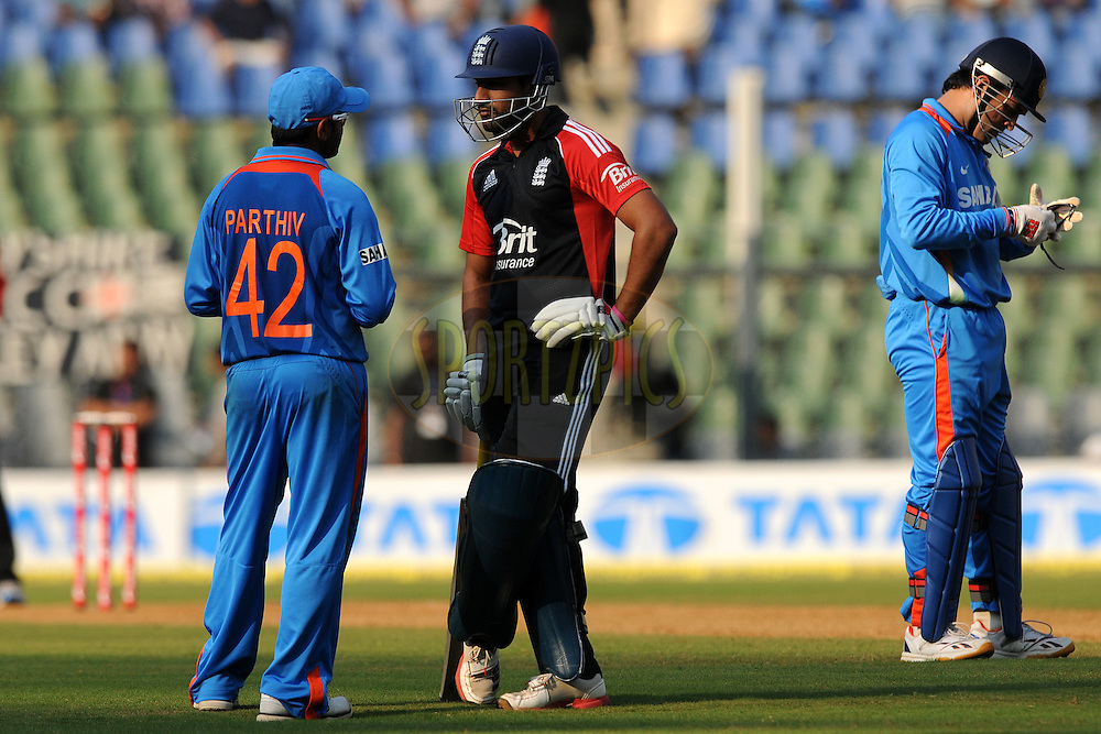 Parthiv patel of India has a causal chat with Ravi Bopara of England during a break during the 4th One Day International ( ODI ) match between India and England held at the Wankhede Stadium, Mumbai on the 23rd October 2011..Photo by Pal Pillai/BCCI/SPORTZPICS