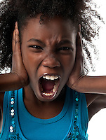Little afro american girl screaming very loud and afraid.