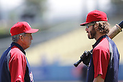 LOS ANGELES - JULY 24:  Manager Davey Johnson #5 of the Washington Nationals talks to Jayson Werth #28 of the Nationals before the game against the Los Angeles Dodgers at Dodger Stadium on Sunday, July 24, 2011 in Los Angeles, California. The Dodgers defeated the Nationals 3-1. (Photo by Paul Spinelli/MLB Photos via Getty Images) *** Local Caption *** Davey Johnson;Jayson Werth