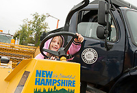 Natasha Main is all smiles as she test drives the lineup of trucks at DPW during Explore A Truck Day on Saturday morning.  (Karen Bobotas/for the Laconia Daily Sun)