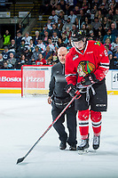 KELOWNA, CANADA - APRIL 14: Portland Winterhawks' athletic therapist Rich Campbell walks Cody Glass #8 of the Portland Winterhawks back to the bench after an on ice injury against the Kelowna Rockets on April 14, 2017 at Prospera Place in Kelowna, British Columbia, Canada.  (Photo by Marissa Baecker/Shoot the Breeze)  *** Local Caption ***